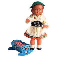 Tiny Hand-Carved and Painted Dora Kuhn Cradle with little Celluloid Bavarian Doll