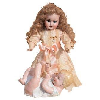 "Endearing 9"" Heubach Piano Baby German Porcelain Figurine"