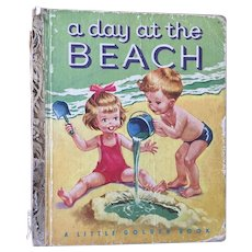 """Vintage Hard Cover Little Golden Book """"A Day at the Beach"""" By Kathryn & Byron Jackson Copyright 1951"""