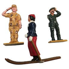 Early American Metallic Toy Soldiers and Lady Skier Circa 1940