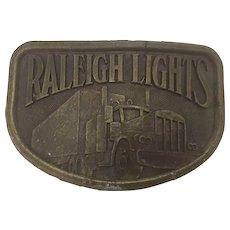 Vintage American cast Trucker's Raleigh Lights Belt Buckle Circa 1980's