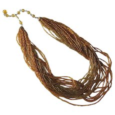 Fabulous vintage liquid gold glass bead necklace - multi 24 strand