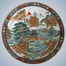 Handpainted Chinese porcelain plate in Famille Rose with landscape decor