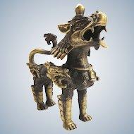Vintage Tibetan brass dragon figurine with armor