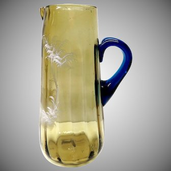Antique Bohemian Mary Gregory jug in brown with blue glass