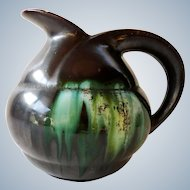 Thulin Belgium - Art Deco pitcher in black and green drip glaze ceramic - 1930s