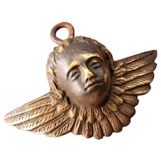 Winged brass or bronze putti head - early 1900s