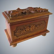 Black forest handcarved wooden cigar box or jewelry casket with holly