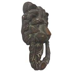 Lion mask door knocker
