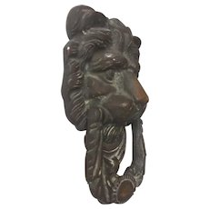 Lion mask door knocker