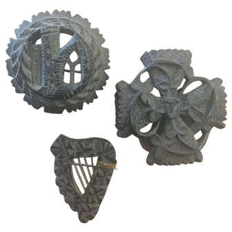 Group of three 19th Century Irish carved bog oak brooches