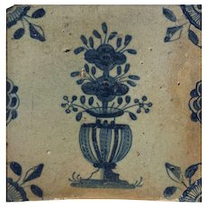 17th Century Delft Tile Decorated with Blue Floral Sprays in a Vase