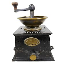 A large Victorian coffee grinder by Baldwin Son and Co
