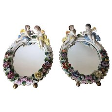 A Pair of early 20th Century German Sitzendorf Porcelain Cherub Barbola Mirrors