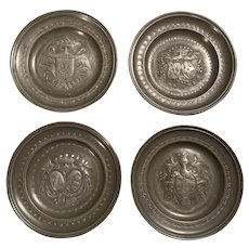 A set of four 18th Century pewter charger plates