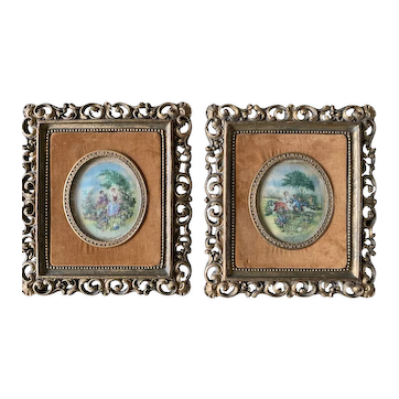 A pair of late Victorian hand-stitched oval panels