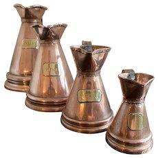 A Graduated set of Four William 1V Copper Measuring Jugs