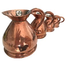 A Set of Four William IV Graduated Copper Measuring Jugs 1830