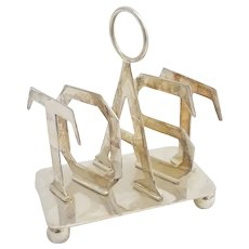 Late 20thC novelty 5-bar toast rack the divisions spelling 'TOAST'