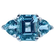Gorgeous Emerald & Trillion Cut Blue Topaz Ring