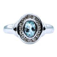 Timeless Bezel Set Aquamarine and Diamond Halo Ring