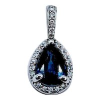Vivid Blue Sapphire and Diamond Halo Pendant