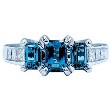Striking Blue Topaz and Diamond Ring