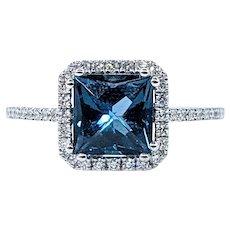 Fashionable London Blue Topaz & Diamond Halo Ring