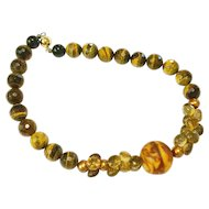 Butterscotch Resin Amber with Gem Quality Beer Quartz on a Golden Tiger's Eye, Pearls, and Black Onyx Necklace
