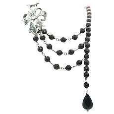 Garnet Layered Necklace With Black Onyx Drop and Crystal Bow