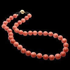 Finest Angel Skin Salmon Coral 10mm 57.5 grams Necklace With Black Onyx Accents