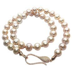 10-11mm Pink Champagne Color Non Nucleated Oval Pearl Necklace Sterling Clasp