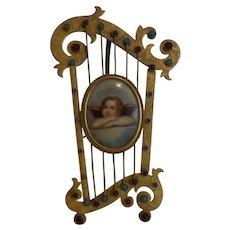 19th C. Painting on Porcelain Cherub, Gilt Bronze Jeweled Harp Frame