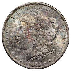 1885-O U.S. Morgan Silver Dollar Coin, New Orleans Mint, Mint State Condition, Rainbow Toning