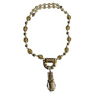 An Elaborate Art Deco Faceted Czech Glass White Enamel and Marcasite Pendant Necklace