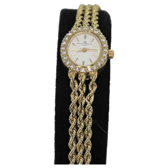 Vintage Gold and 1/3 ctw  Diamond Baume and Mercier Watch, 14K