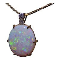 11 Carat Australian Opal Pendant in 14 Karat Yellow Gold Set with Diamonds