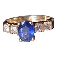14 Karat Yellow Gold Sapphire Engagement Ring set with Diamonds
