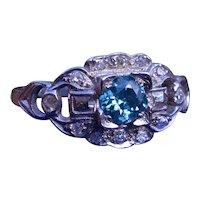 Antique Platinum Ring set with 0.52 carat Fancy Deep Blue Diamond