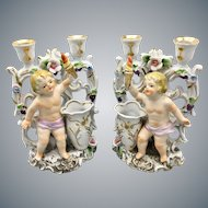 Antique Camille Naudot French Porcelain Candlesticks with Cherubs and Flowers