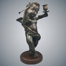 Large Bronze Cherub Cupid with Arrow and Candleholder Mounted on Wood