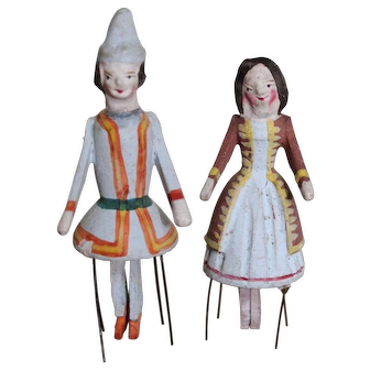 A Charming Pair of Wooden Spinet. Bristle Dolls