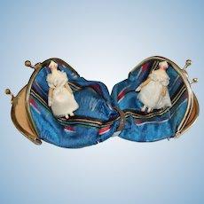 A Pair of Sweet Grodnertal Dolls In A Victorian Silk Purse