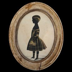 An English 19th Century Oval Silhouette Of A Young Child