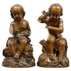Pair of Carved walnut gothic cherub figures