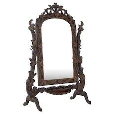 19th Century carved lindenwood black forest vanity mirror
