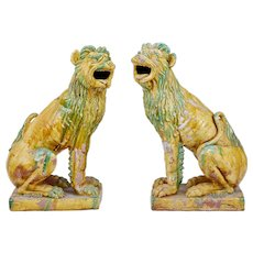 Pair of 20th century tall Indonesian salt glazed decoration dogs