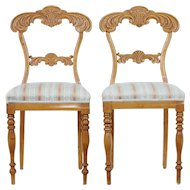Pair of early 20th century carved birch chairs