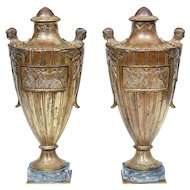Fine pair of French solid bronze and gilt decorative urns