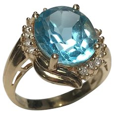 14 K Yellow Gold 6.00 Carat Oval Shape Faceted Topaz Diamond Ring.